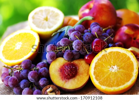 Slices of peach, grapes and citrus fruits - stock photo