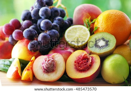 Slices of peach, grapes, kiwi and citrus fruits
