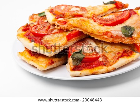 slices of pizza margharita on a white plate - stock photo