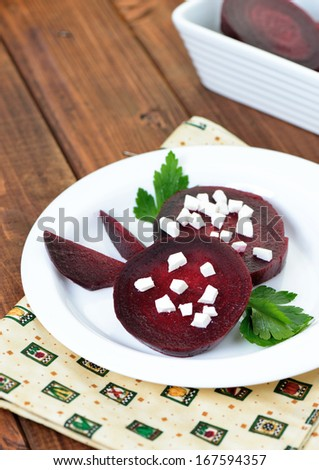 Slices of red beet with goat cheese