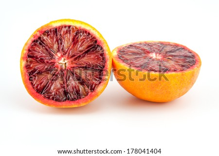 slices of red blood oranges on a white background