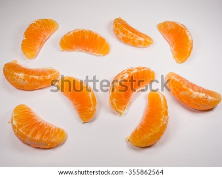 Slices of ripe and fresh mandarin or tangerine isolated on white background - stock photo