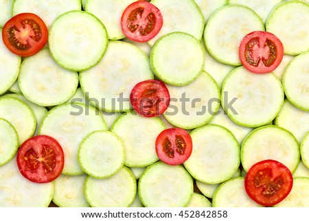 Slices of ripe fruits of zucchini and tomatoes (texture, background)