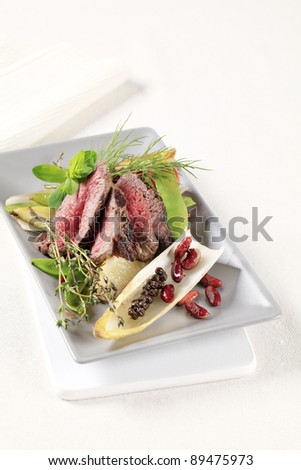 Slices of roast beef  and vegetable garnish