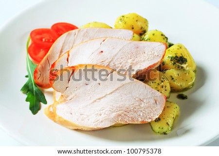 Slices of roast turkey breast with potatoes   - stock photo