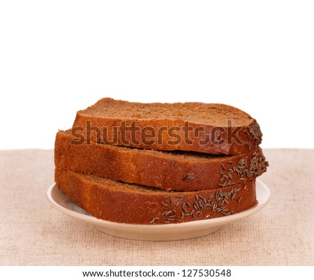 Slices of rye bread for sandwich on a plate over white