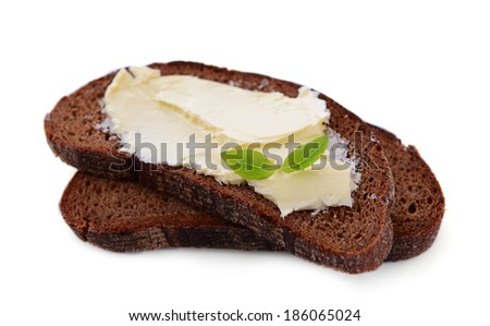 Slices of rye bread with butter, isolated on white