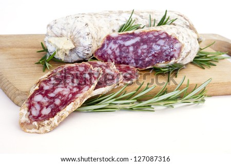 Slices of Salame from Italy on Wooden table