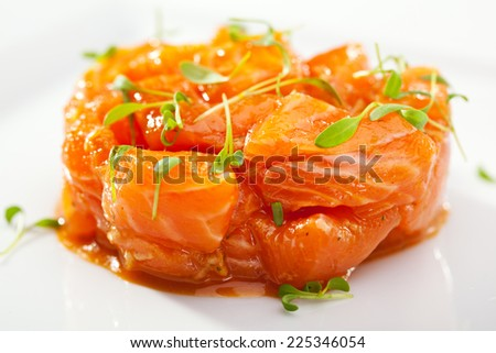 Slices of Salmon Served with Spicy Sauce - stock photo