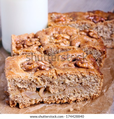 Slices of snack whole meal cake with apples walnut, square image