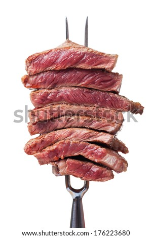 slices of steak on a meat fork  - stock photo
