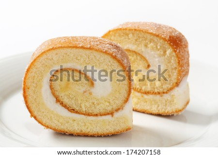 Slices of sweet cream roll on a plate - stock photo