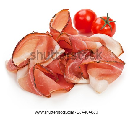 Slices of tasty spanish ham on white background  - stock photo