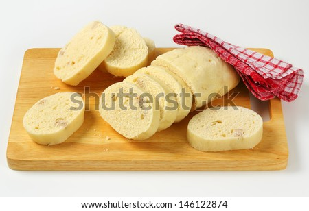 Slices of traditional czech dumplings on a cutting board