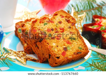 slices of traditional dried fruits cake for christmas - stock photo