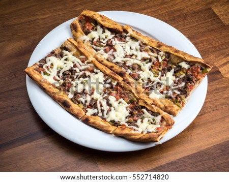 slices of traditional Turkish beef Pide on white plate