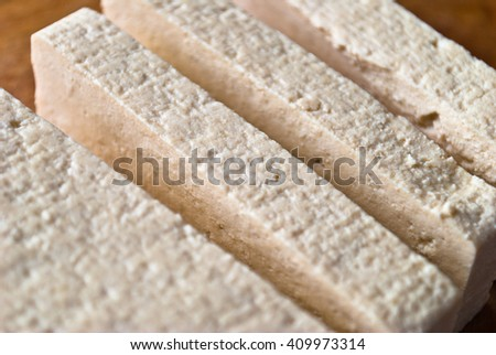 Slices of uncooked tofu. Raw ingredients for vegetarian cuisine - stock photo