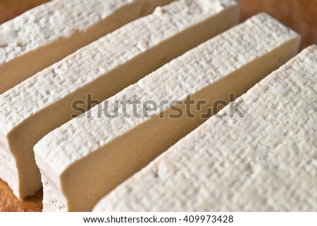 Slices of uncooked tofu. Raw vegetarian meal - stock photo