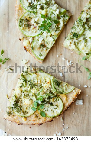 slices of vegetable pizza with cheese, top view