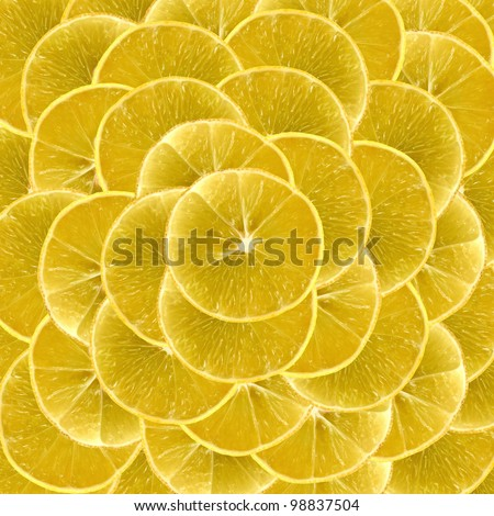 Slices of vibrant lemon arranged one above another and can be used as backgrounds - stock photo