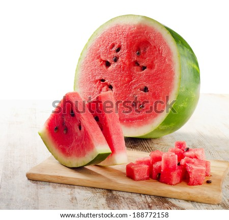 slices of watermelon on wooden table isolated on white - stock photo