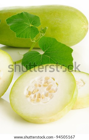 Slices of wax gourd on white