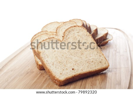 Slices of wheat bread against a white background