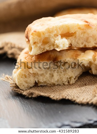 slices of white bread lavash on a dark background
