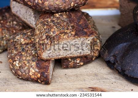 Slicing crusty bread - stock photo
