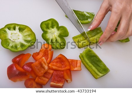 Slicing Red and Green Bell Peppers - stock photo
