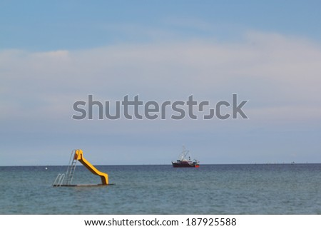 slide in the water at the coast - stock photo