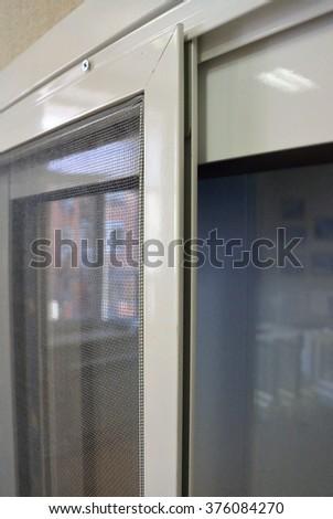 slide mosquito net on the balcony glazing - stock photo