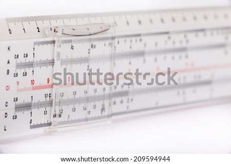 Slide ruler for mathematical calculations isolated on white background - stock photo