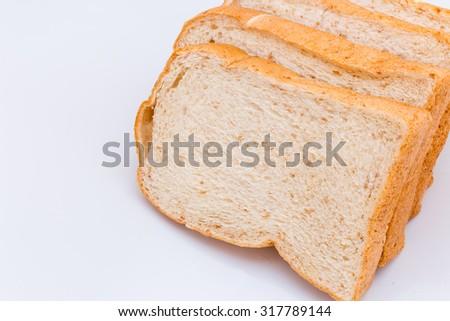 Slide whole wheat on white background - stock photo