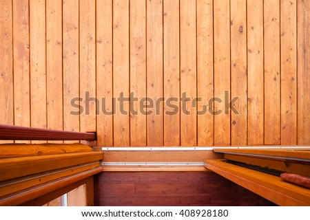Sliding door open doorway onto wooden deck or porch from straight above with rich warm wood colors and textures - stock photo