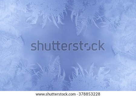 Slightly blurred beautiful frost pattern on a window glass (with empty space for your text or image) - stock photo