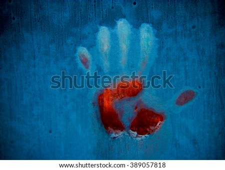 Slightly blurred bloody handprint on a frozen window (symbolizing horror or fear, with copy space for your text) - stock photo