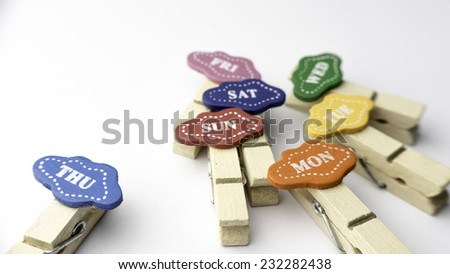 Slightly defocused and close-up short form for Monday, Tuesday, Wednesday, Thursday, Friday, Saturday and Sunday word on clothes peg. Concept of day in a week. - stock photo