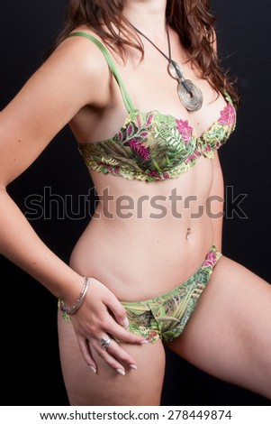 Slim and Sexy brunette woman in lingerie - stock photo