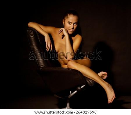 Slim beautiful woman laying on sofa - stock photo