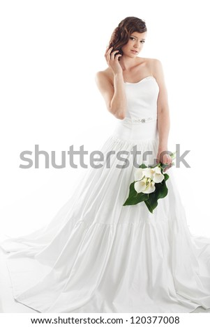 Slim beautiful woman wearing luxurious wedding dress over white studio background - stock photo