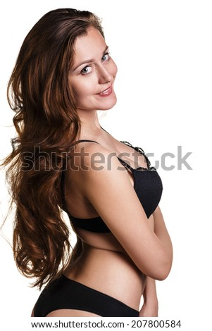Slim body of young woman in black bikini. Girl with healthy sporty figure isolated on white background