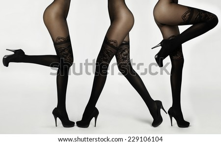 Slim female legs in pantyhose. Conceptual fashion art photo - stock photo