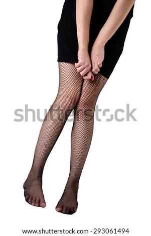 slim female legs in stockings  - stock photo