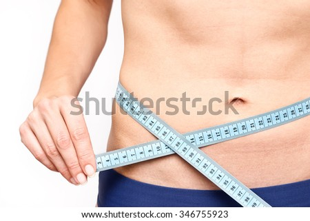 Slim Female Measuring her thin waist with a tape measure. Unrecognizable person.Diet and weight loss concept.