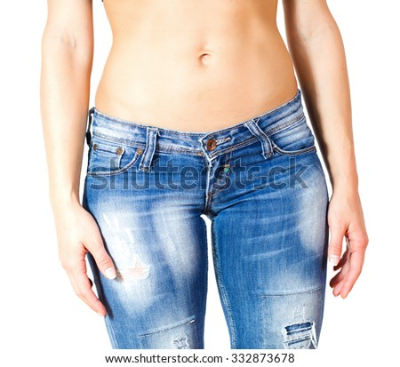 Slim Female with perfect healthy fit body, showing her thin waist.  Caucasian young woman in jeans, over white background. Unrecognizable person.Diet and weight loss concept. - stock photo
