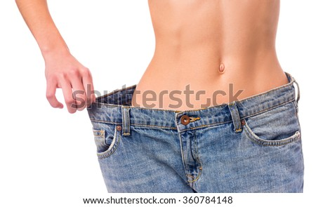 Slim girl demonstration of their weight loss for example jeans