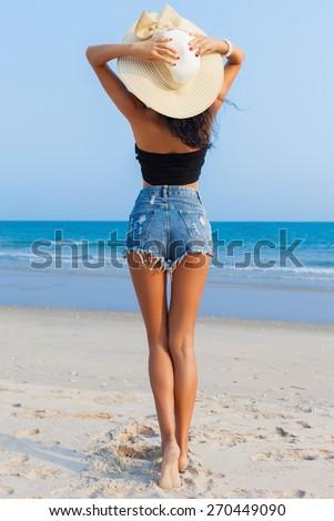 Slim girl enjoying the beach - stock photo