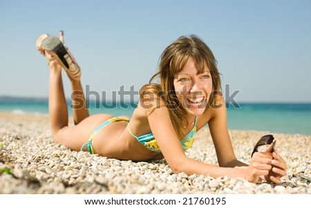 Slim girl on seashore