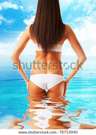 slim healthy woman body in the sea water - stock photo